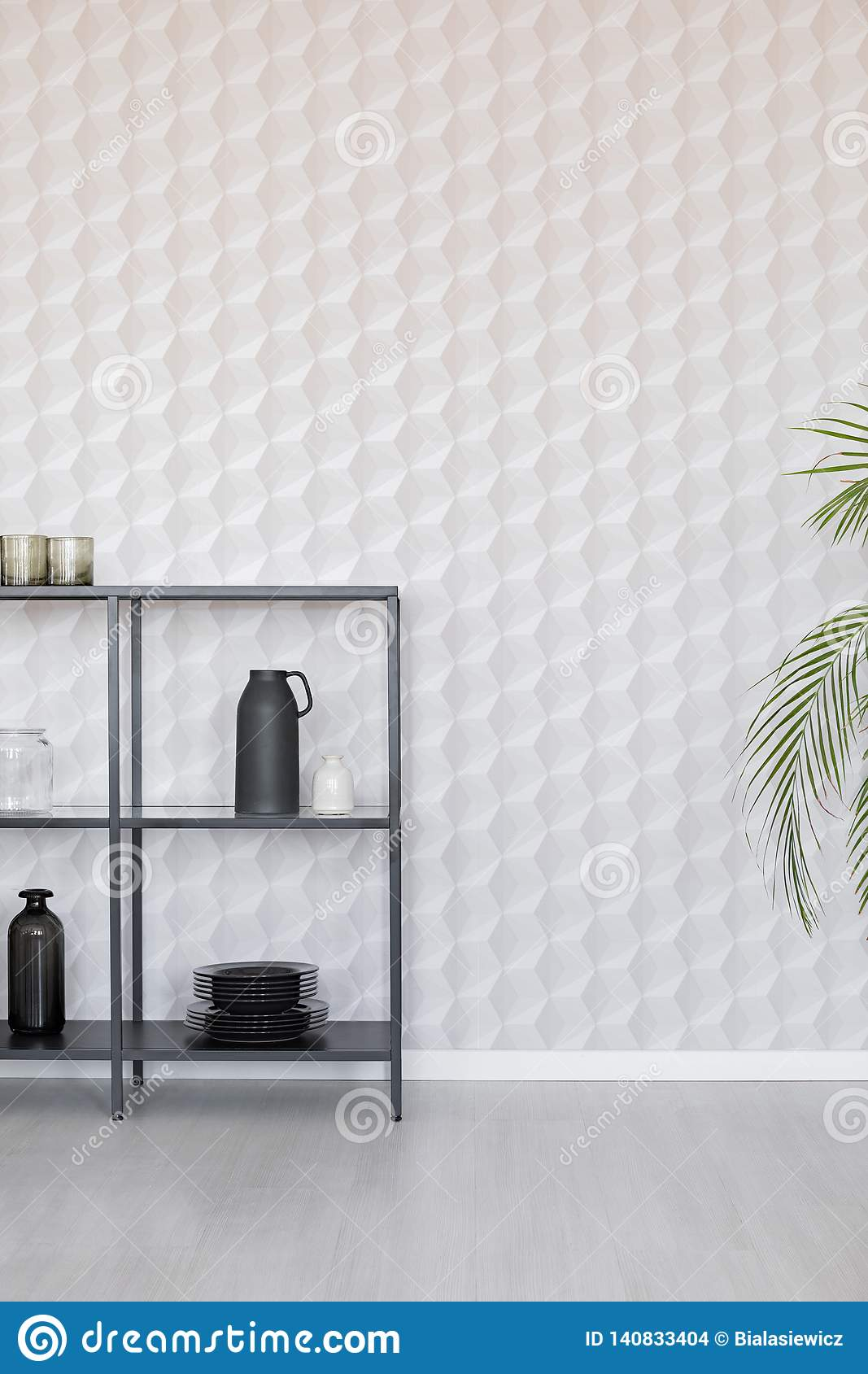 Metal shelf with vases, plate and accessories on empty wall wall with unique wallpaper, real photo with copy space