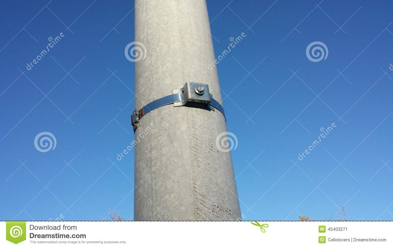 Concrete Light Pole : Metal sign clasp on utility pole stock image of