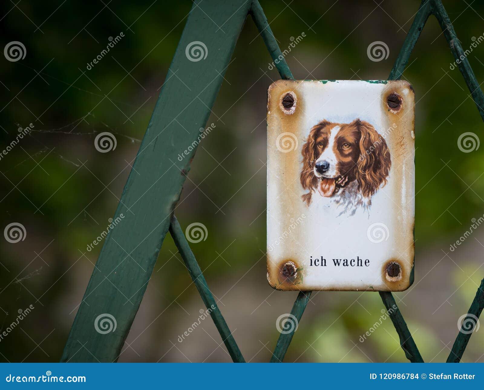 Metal sign with dog saying