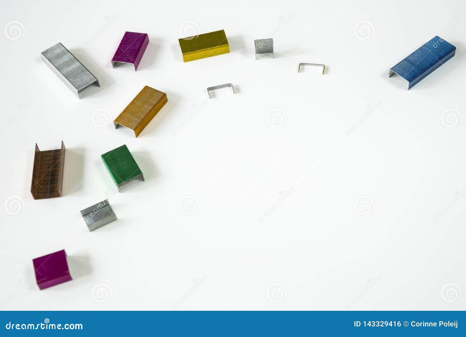 Marvelous Metal Staplers In Various Metallic Colors On White Desk Home Remodeling Inspirations Basidirectenergyitoicom