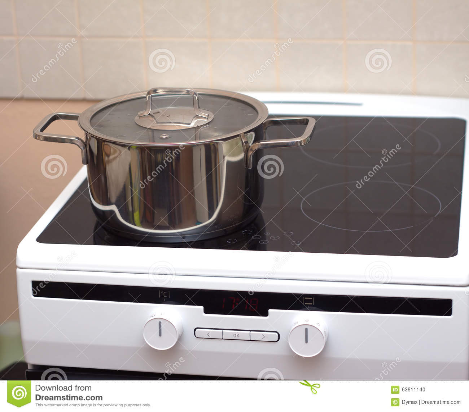 Metal Steel Saucepan On Modern Kitchen Electric Stove