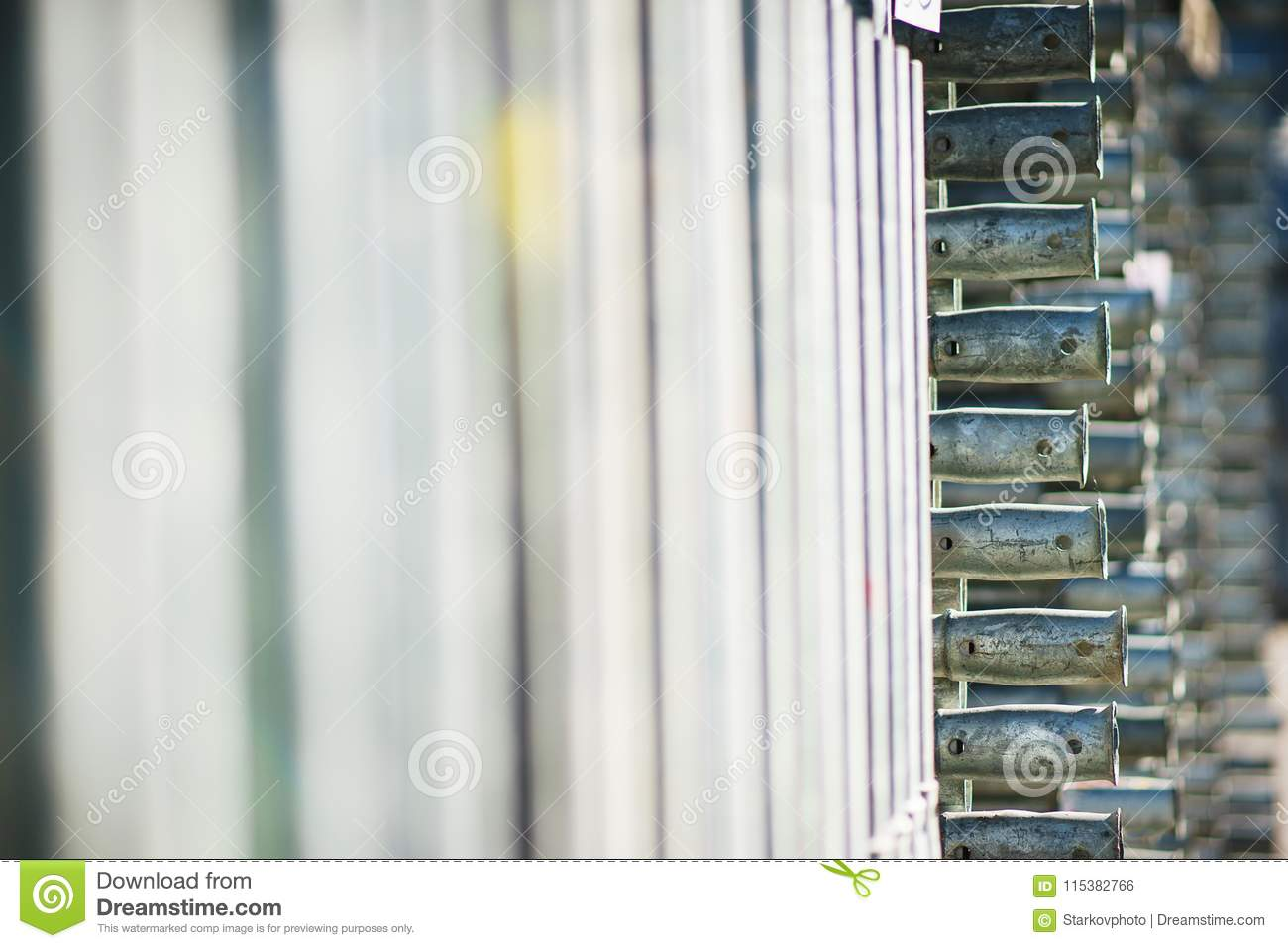 Metal Structures In A Warehouse In Stacks. Metal Supports For Scaffolding  And Formwork.