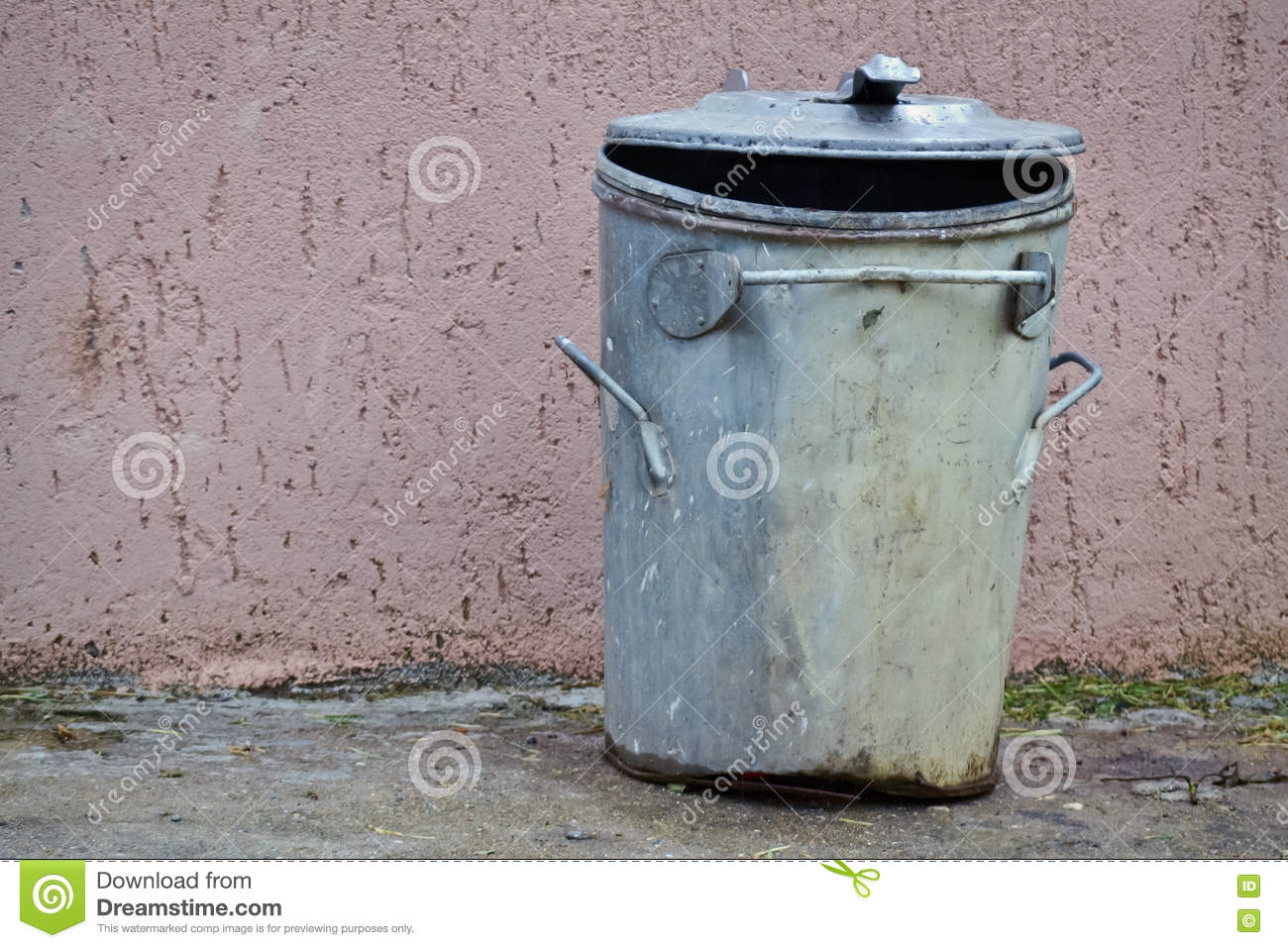 Old Open Corrugated Metal Garbage Bin With Lid Leaning Against It Stock Image