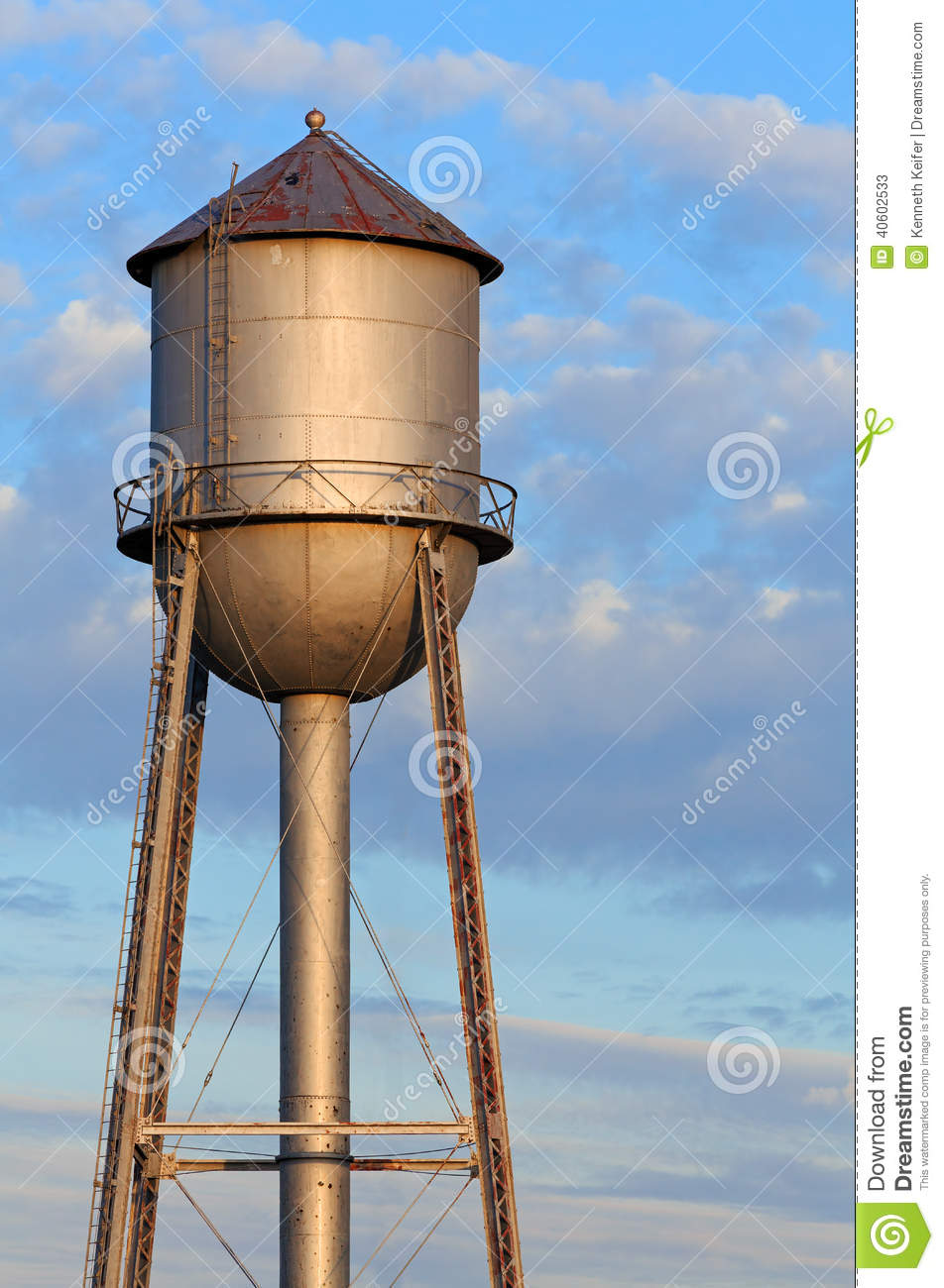 Water Tower Tank : Metal water tower and morning sky stock image