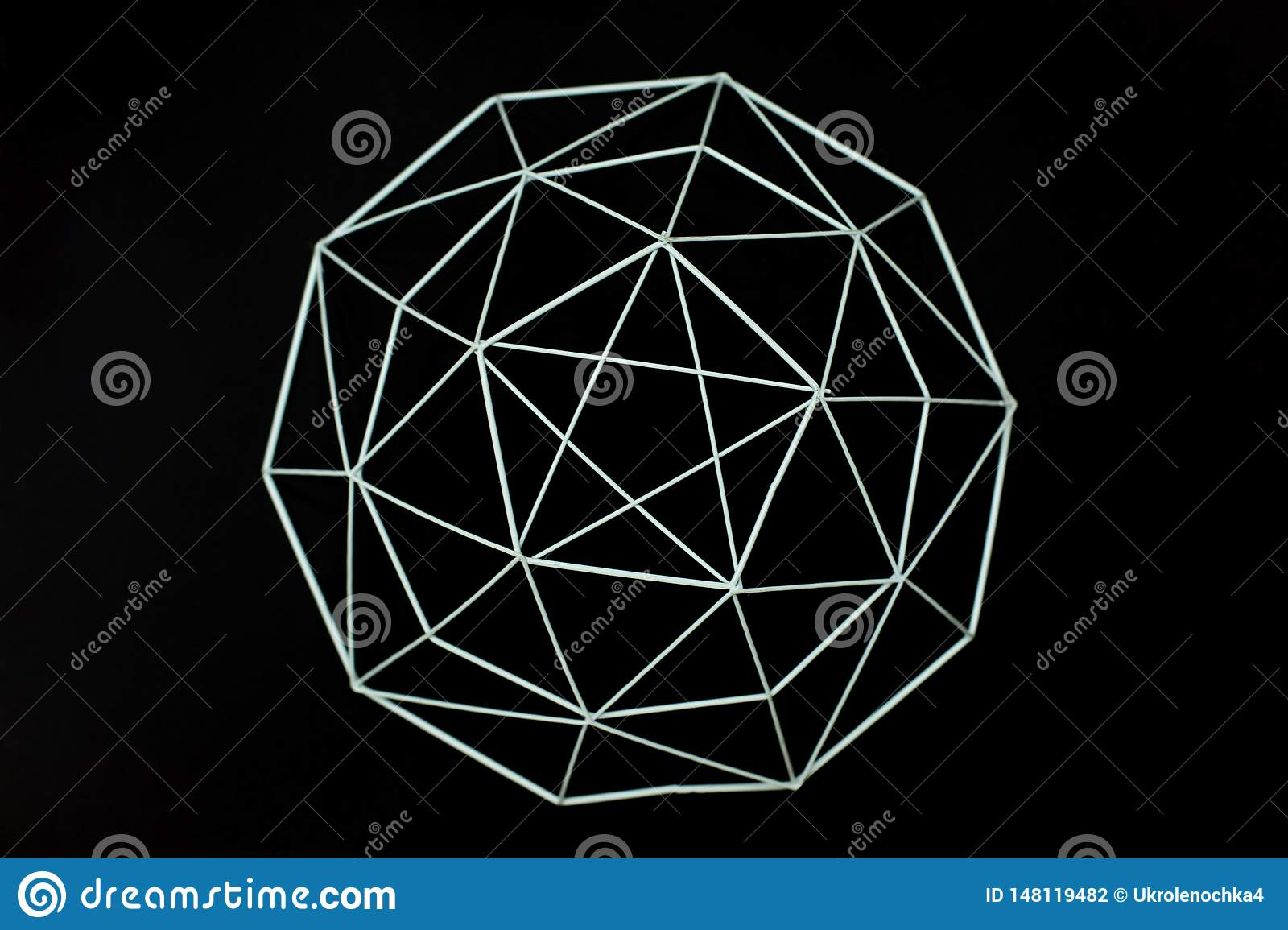 Metal wire decorative geometric elements, basket, vase on a black background. MInimal concept. Beautiful abstract pattern of metal