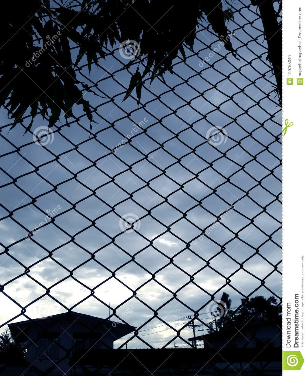 Metal Wire Mesh And Evening Blue Sky In Background Stock Photo ...