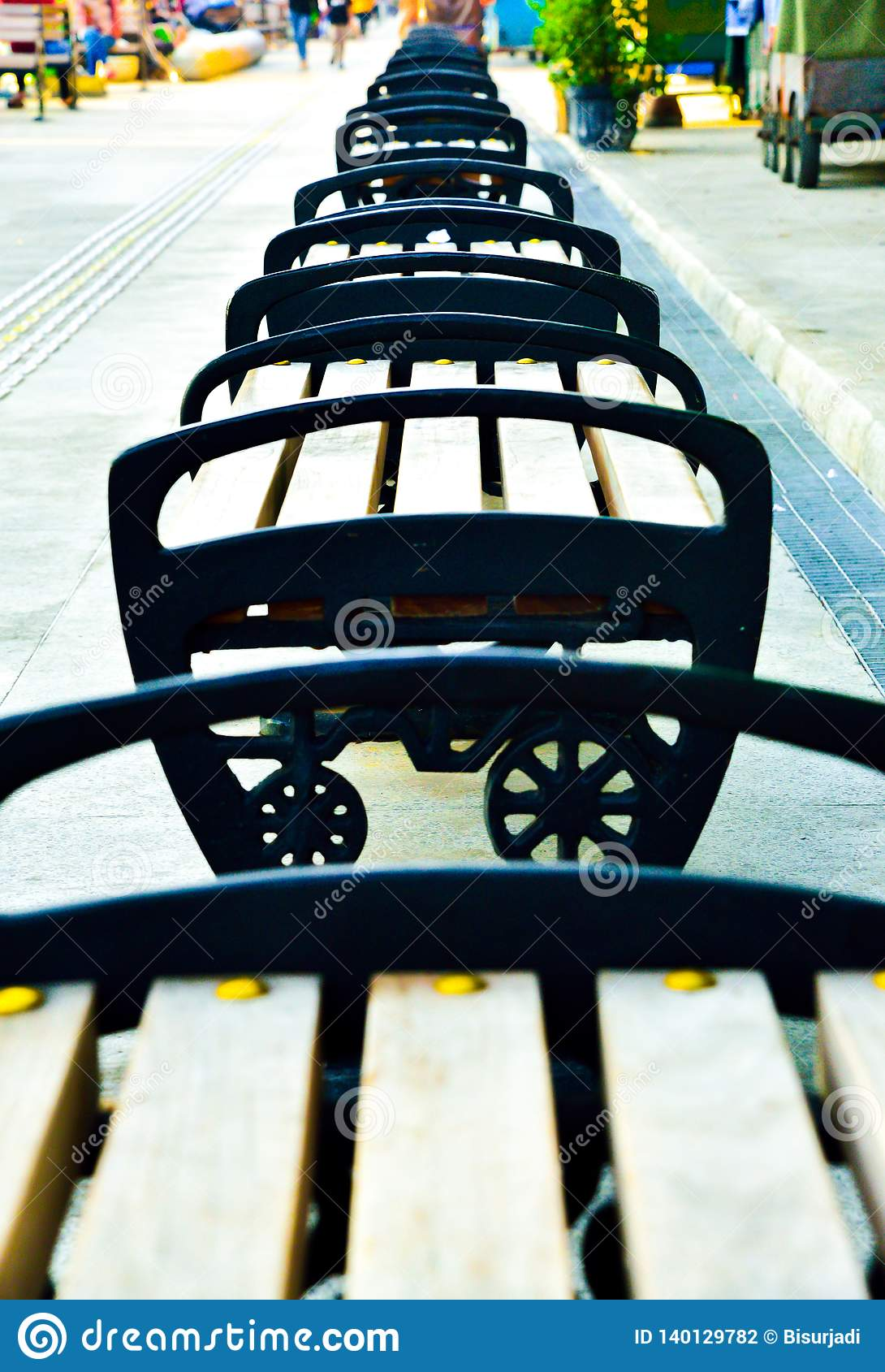 Rows of wood and metal chair on the open air shopping street in South East Asia