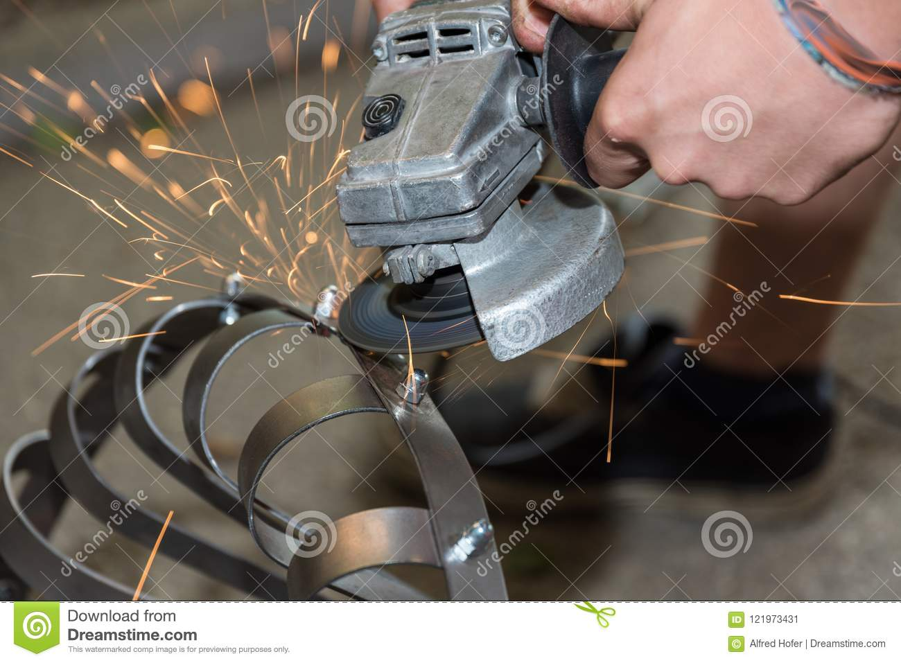 Metal worker with angle grinder - sparking