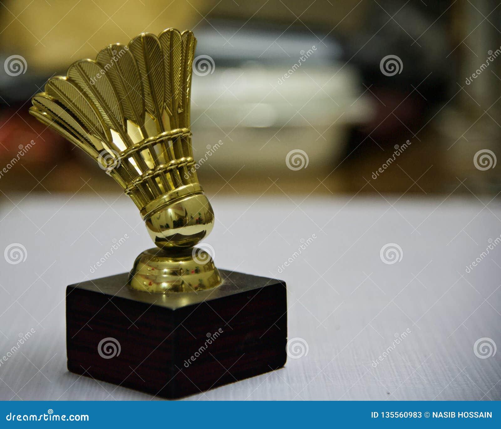 A metallic artificial badminton cork