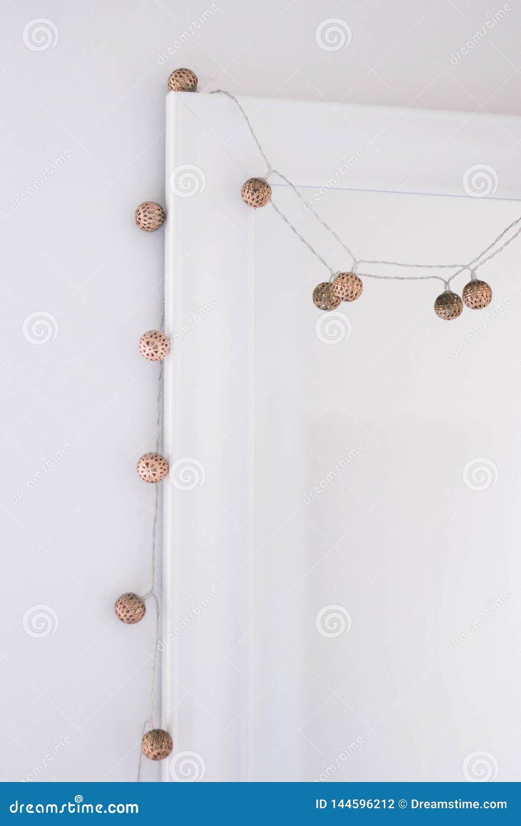 Metallic fairy lights hanging around mirror