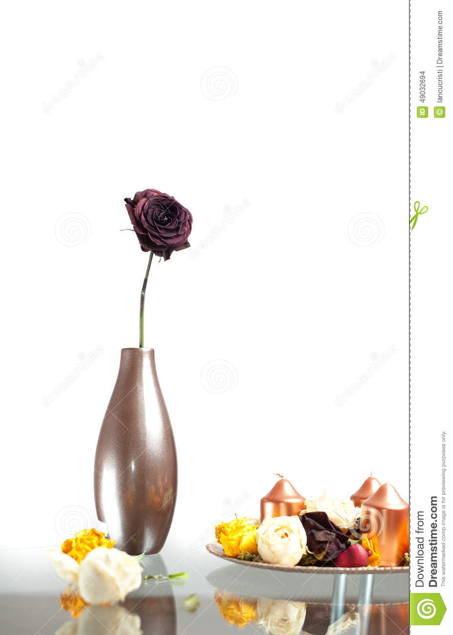 Metallic Vase With One Rose Flower On The Table Over White