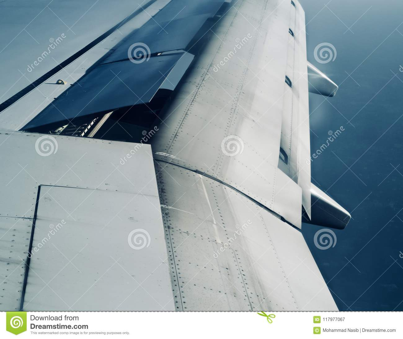 Download A Metallic Wings Of An Aircraft In The Sky  Photograph Stock Image - Image of large, background: 117977067