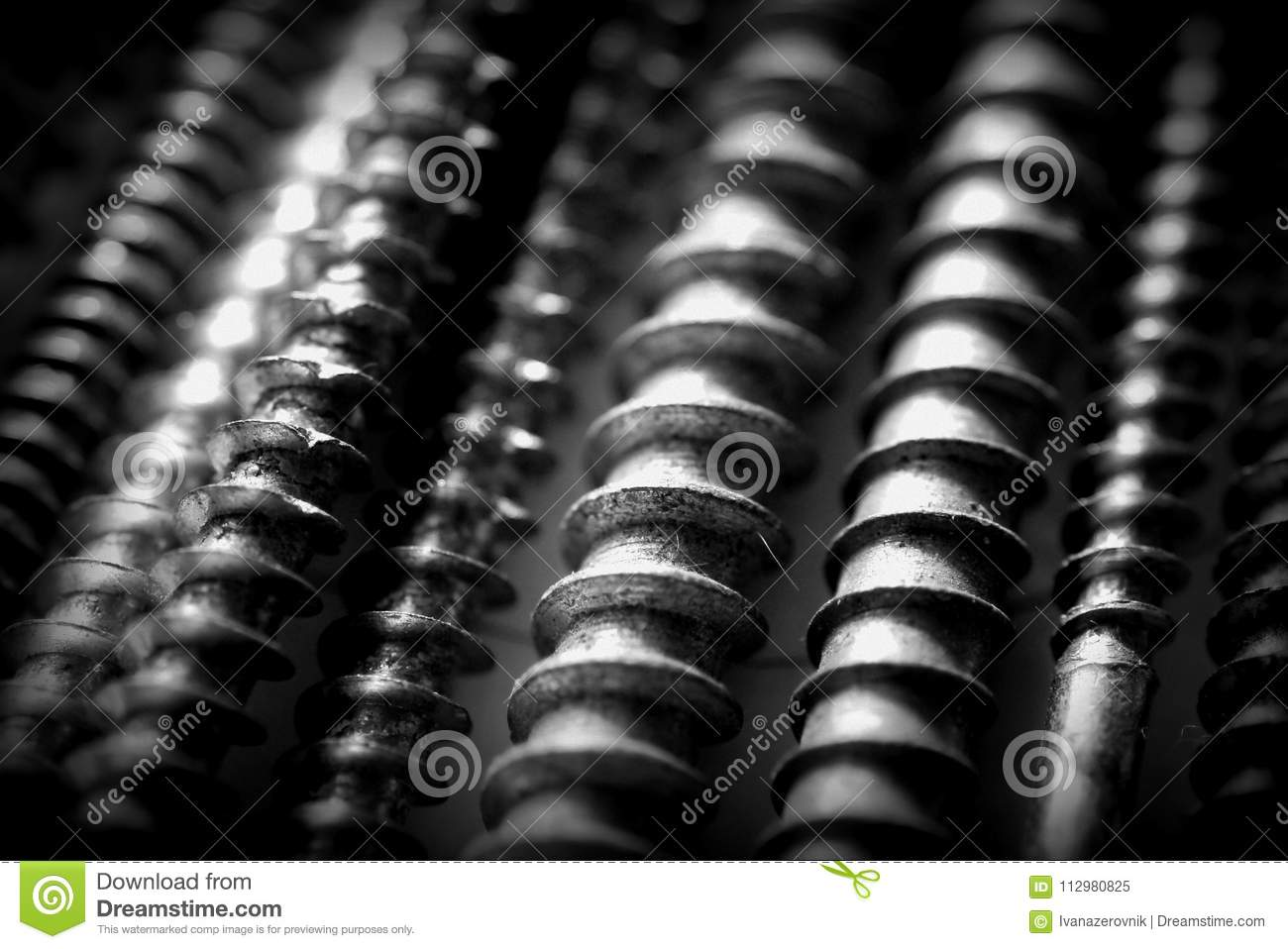 Bunch of an old metal screws fills background