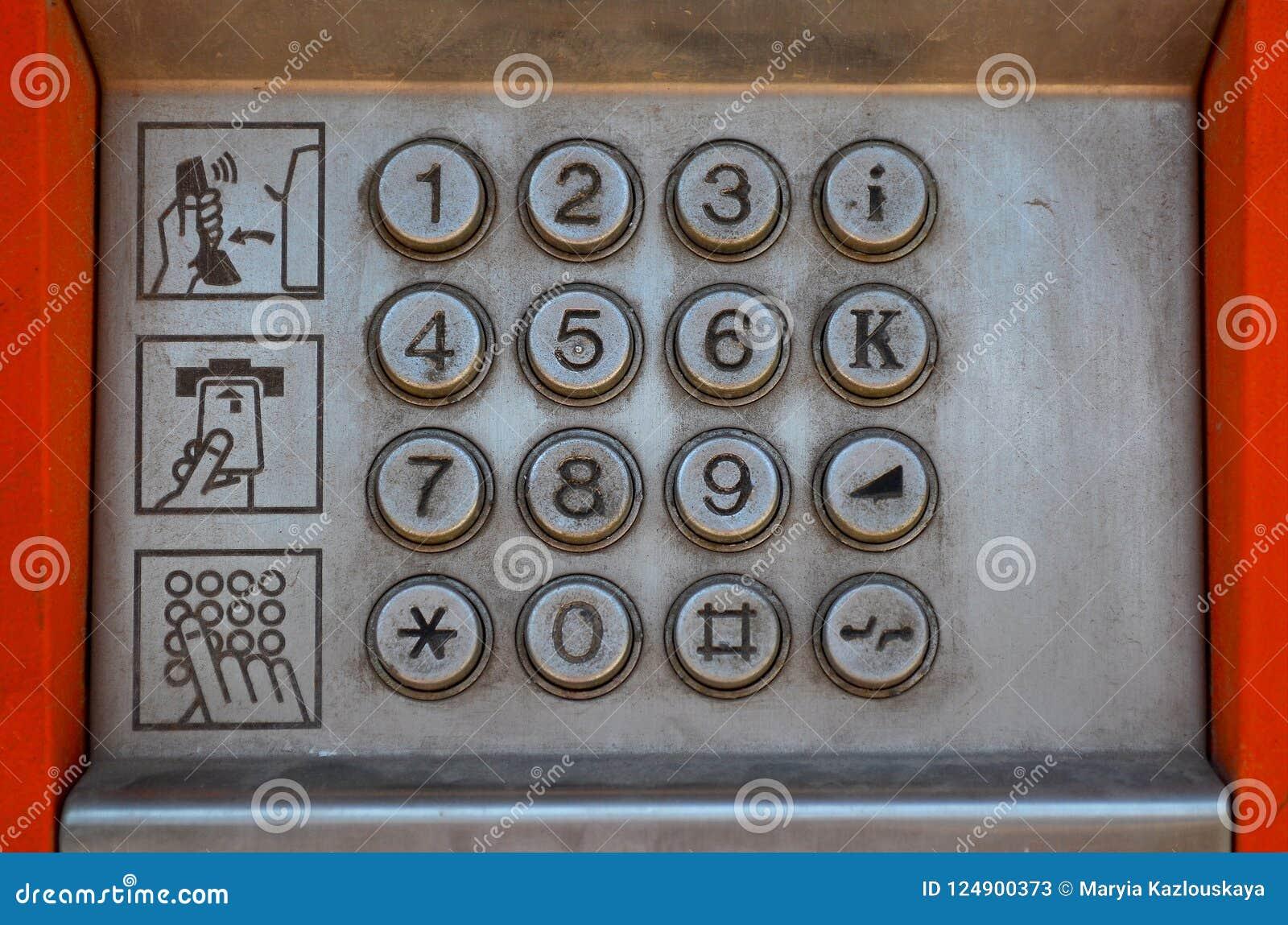 Metalu panel uliczny payphone z guzikami i trzy piktogramami z instrukcjami dla use