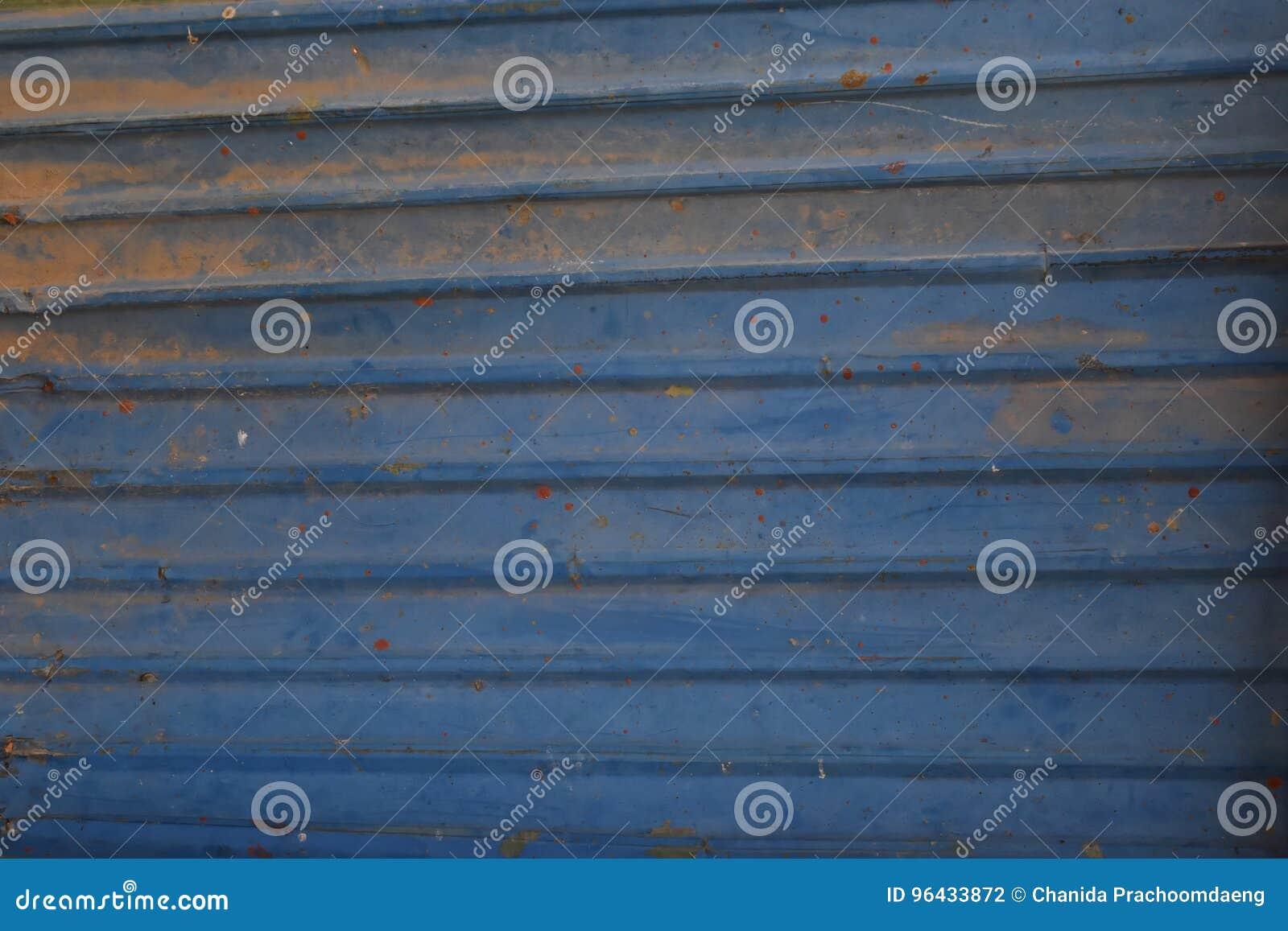 Metalu tła stalowy stary błękitny drzwi i abstrakt tekstury brudna żaluzja