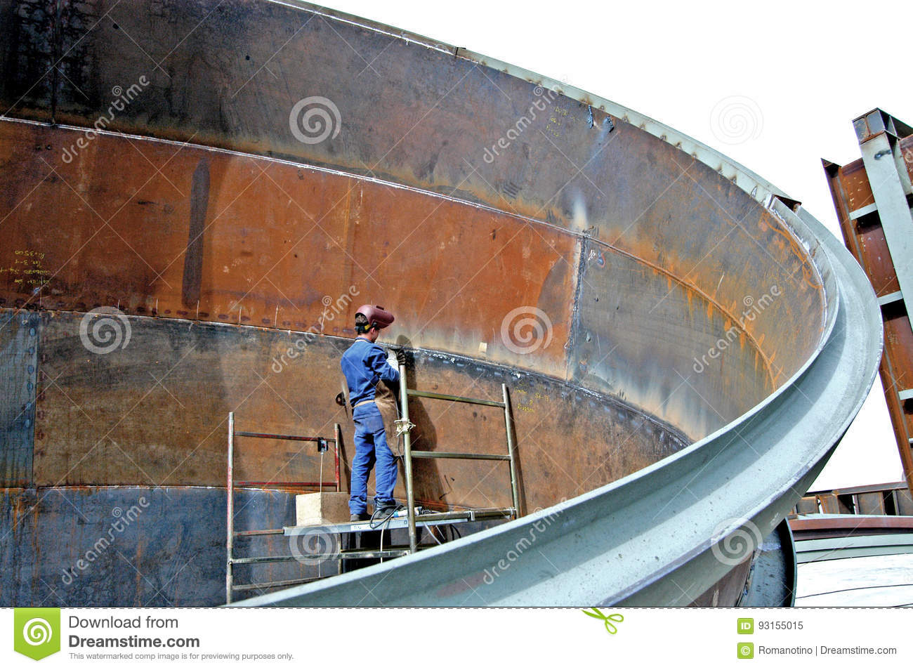 Metalwork Construction Of Large Tubes With Workers Working Welding