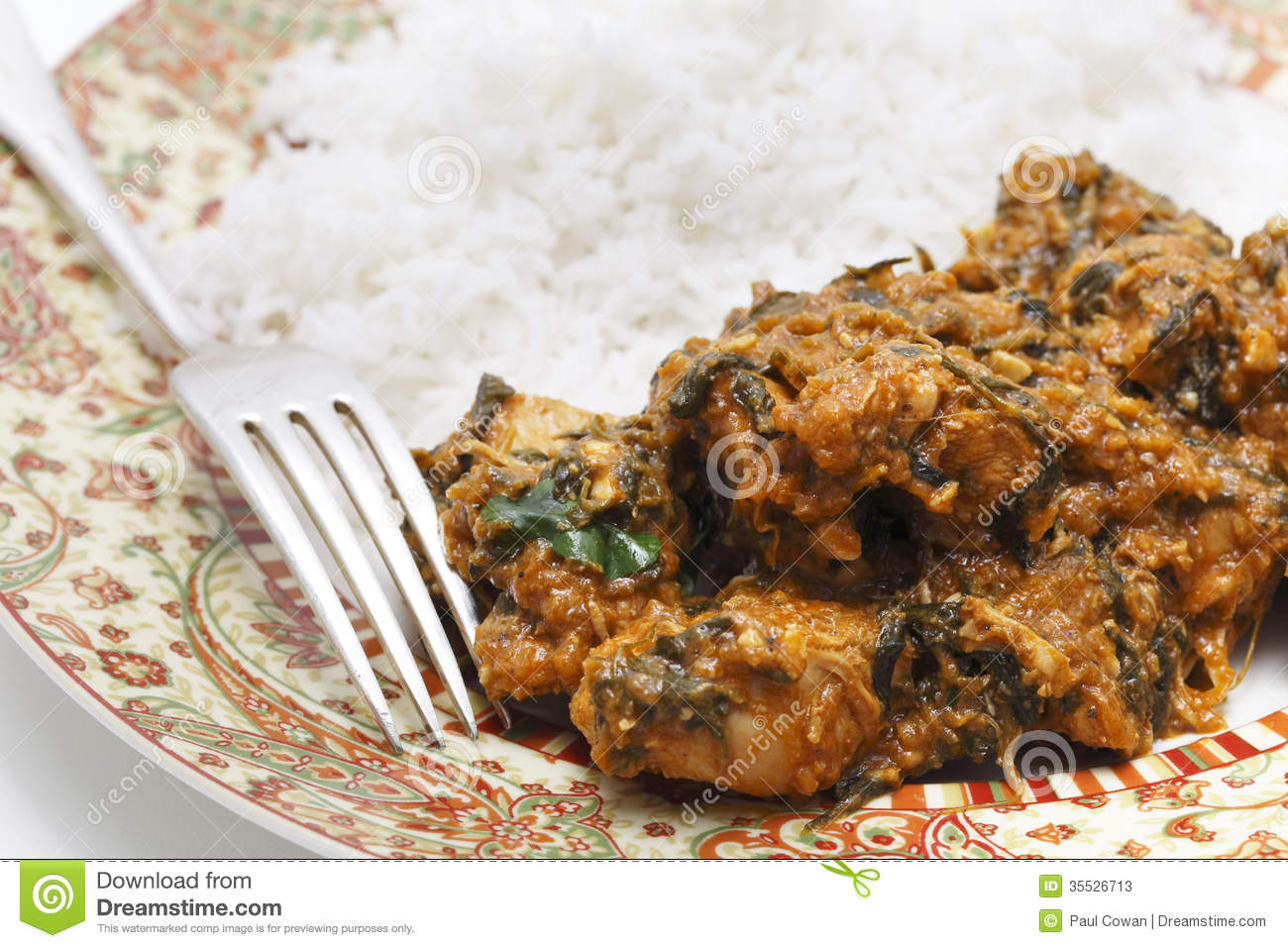 Methi murgh - chicken cooked with fresh fenugreek leaves on a plate ...
