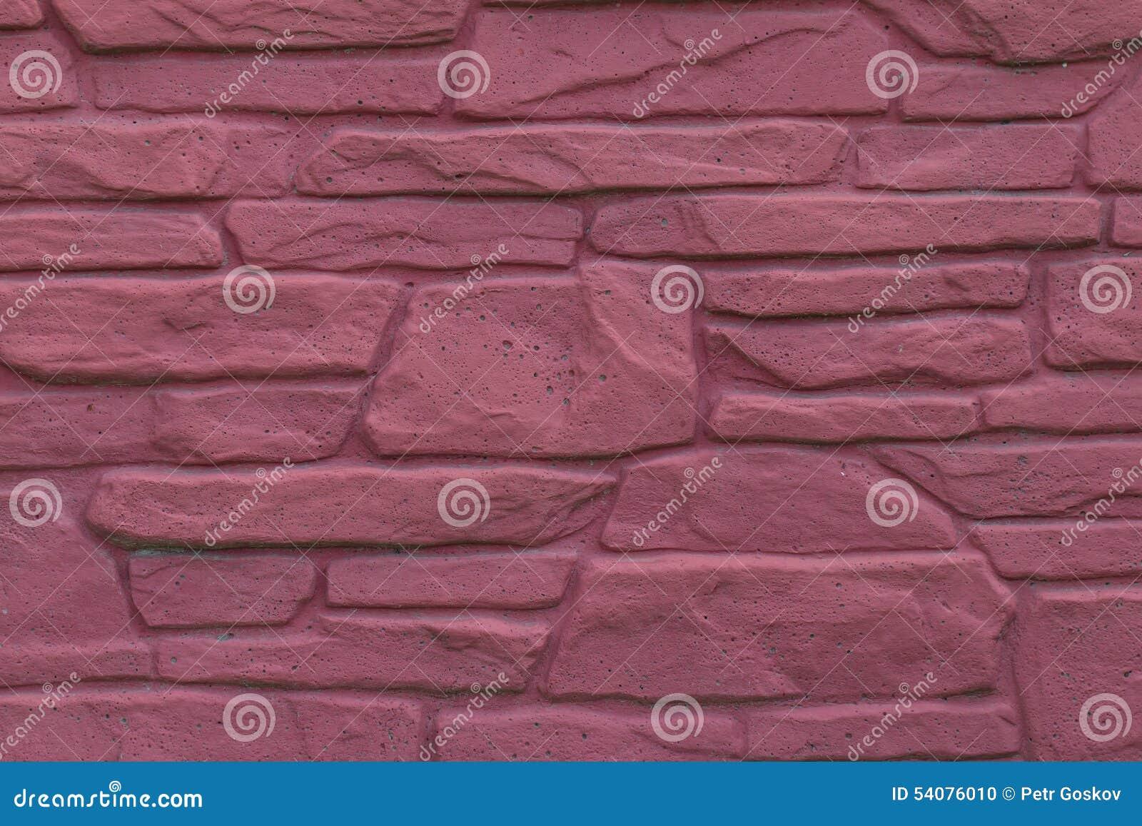 Metselwerkmuur van rode steen