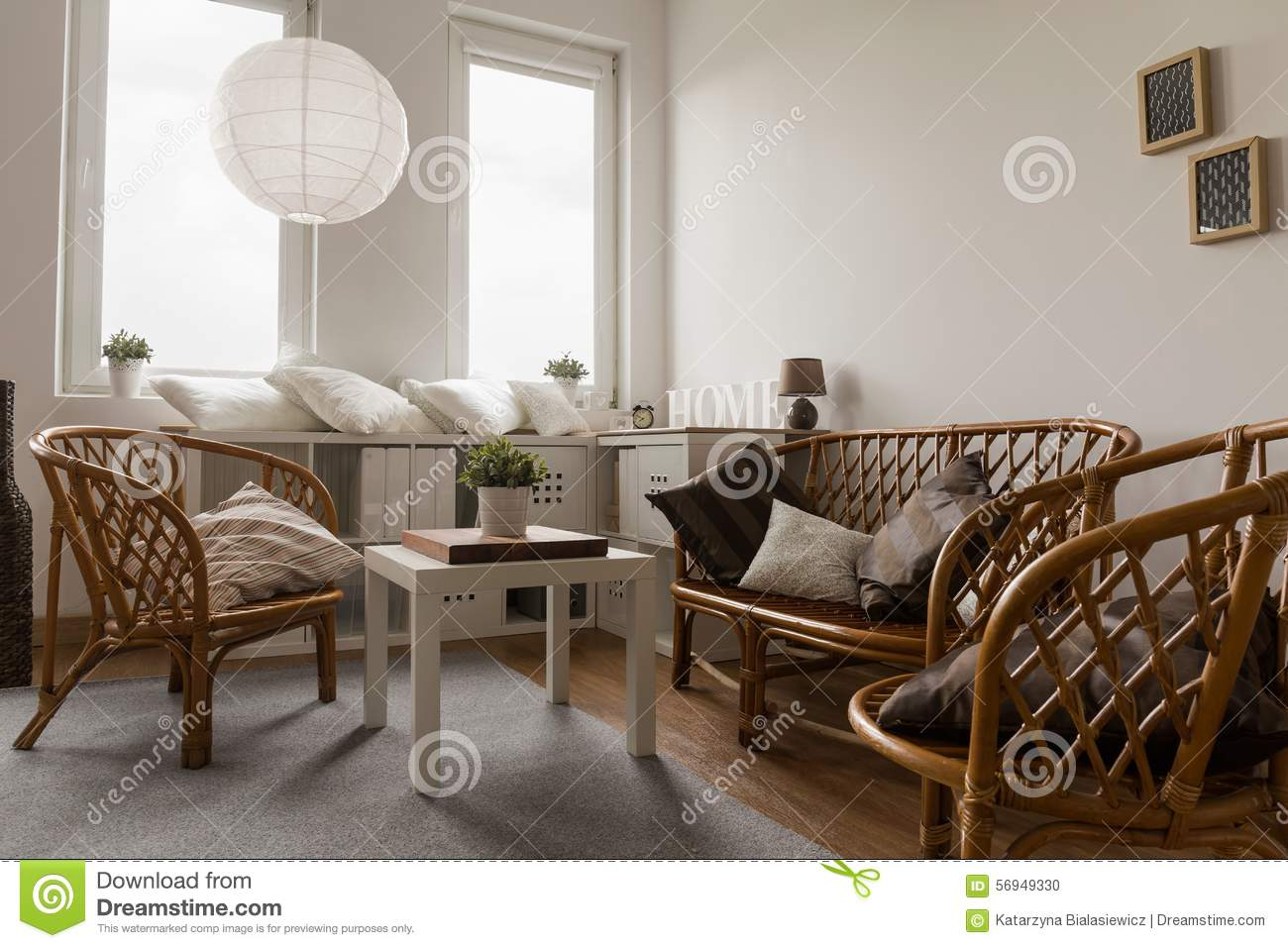 meubles en osier dans le salon photo stock image 56949330. Black Bedroom Furniture Sets. Home Design Ideas