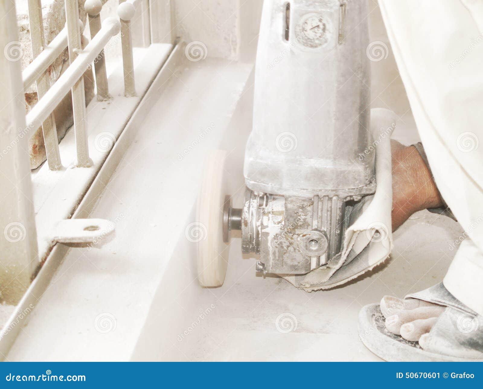 Meulage du plancher carrelé