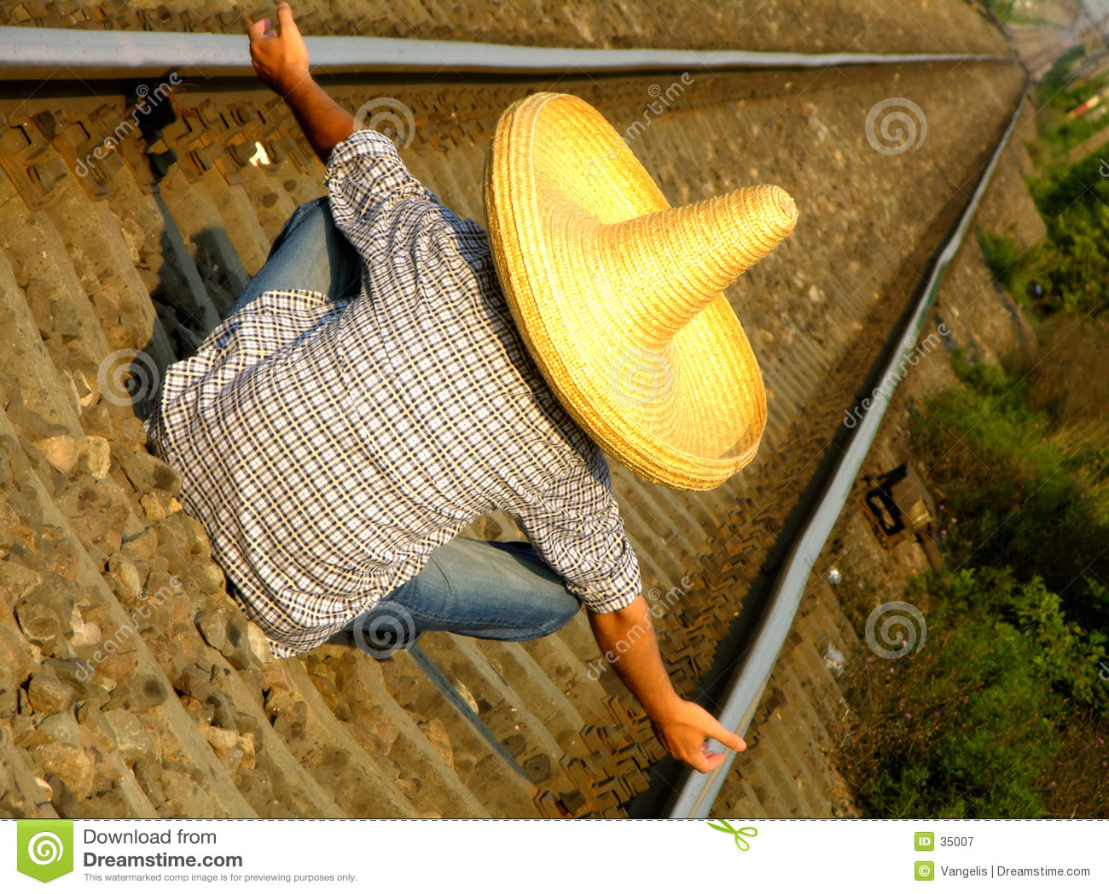 Mexicaanse kerel die de trein wacht