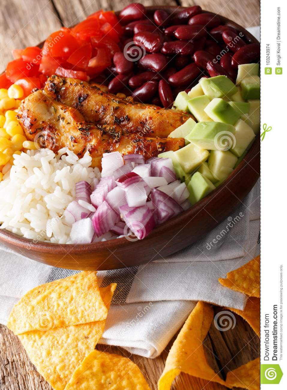 Mexican burrito bowl with grilled chicken, rice and vegetables c
