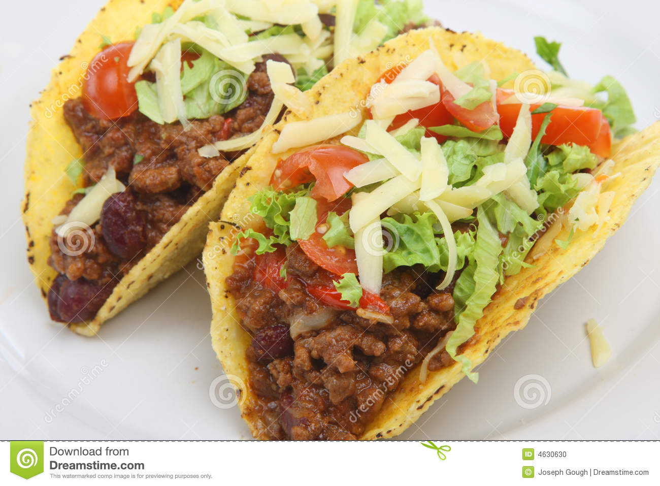 ... shells filled with spicy chilli beef, tomatoes, lettuce and cheese
