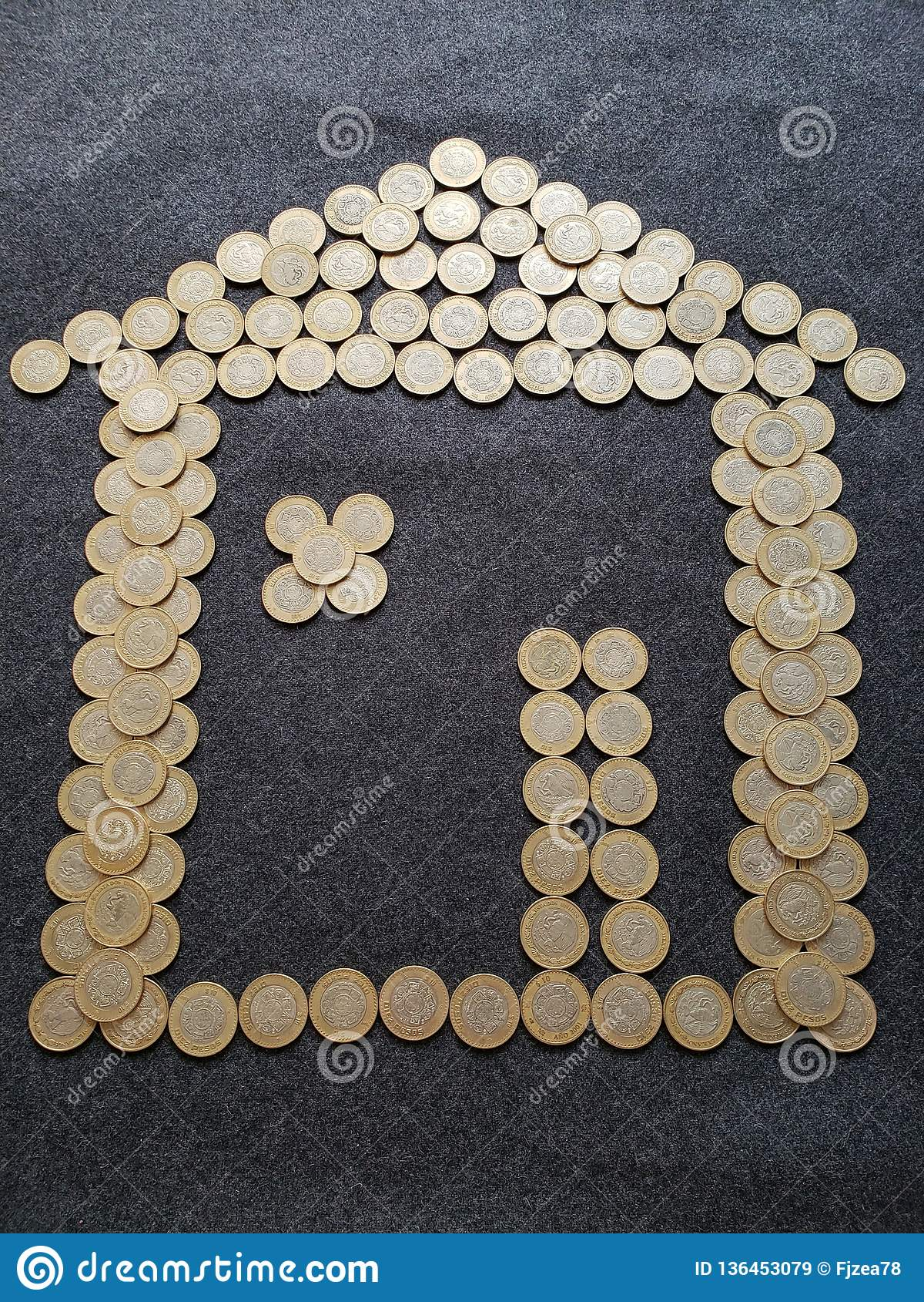 Mexican Coins Of Ten Pesos Forming A House Figure Stock