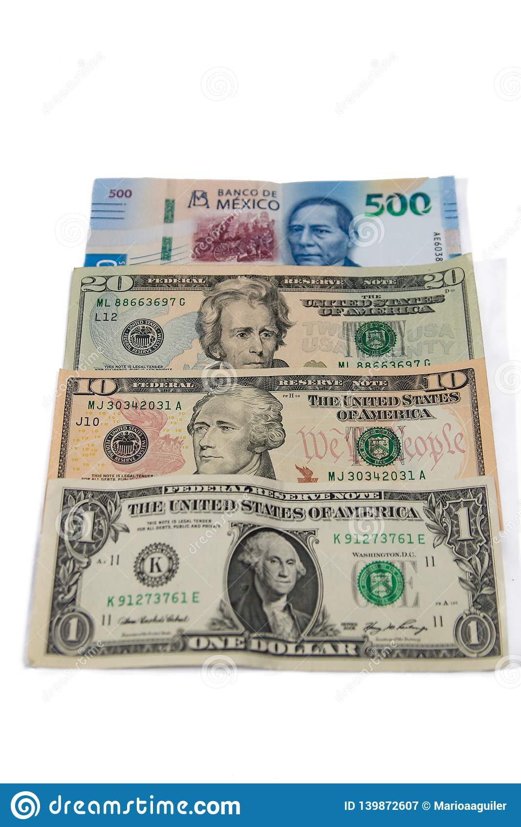 Mexican currency between dollars