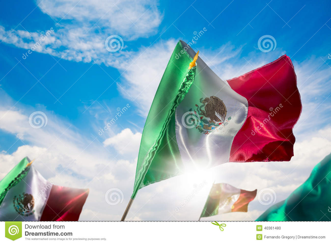 Mexican flags against a bright sky, independence day, cinco de m