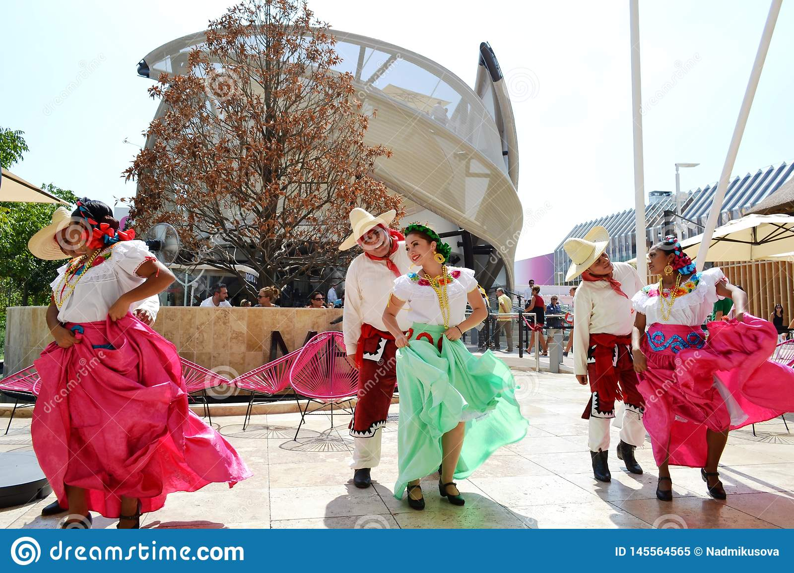 Mexican folklore dancers are dancing passionately in front of the Mexico pavilion at EXPO Milano 2015.