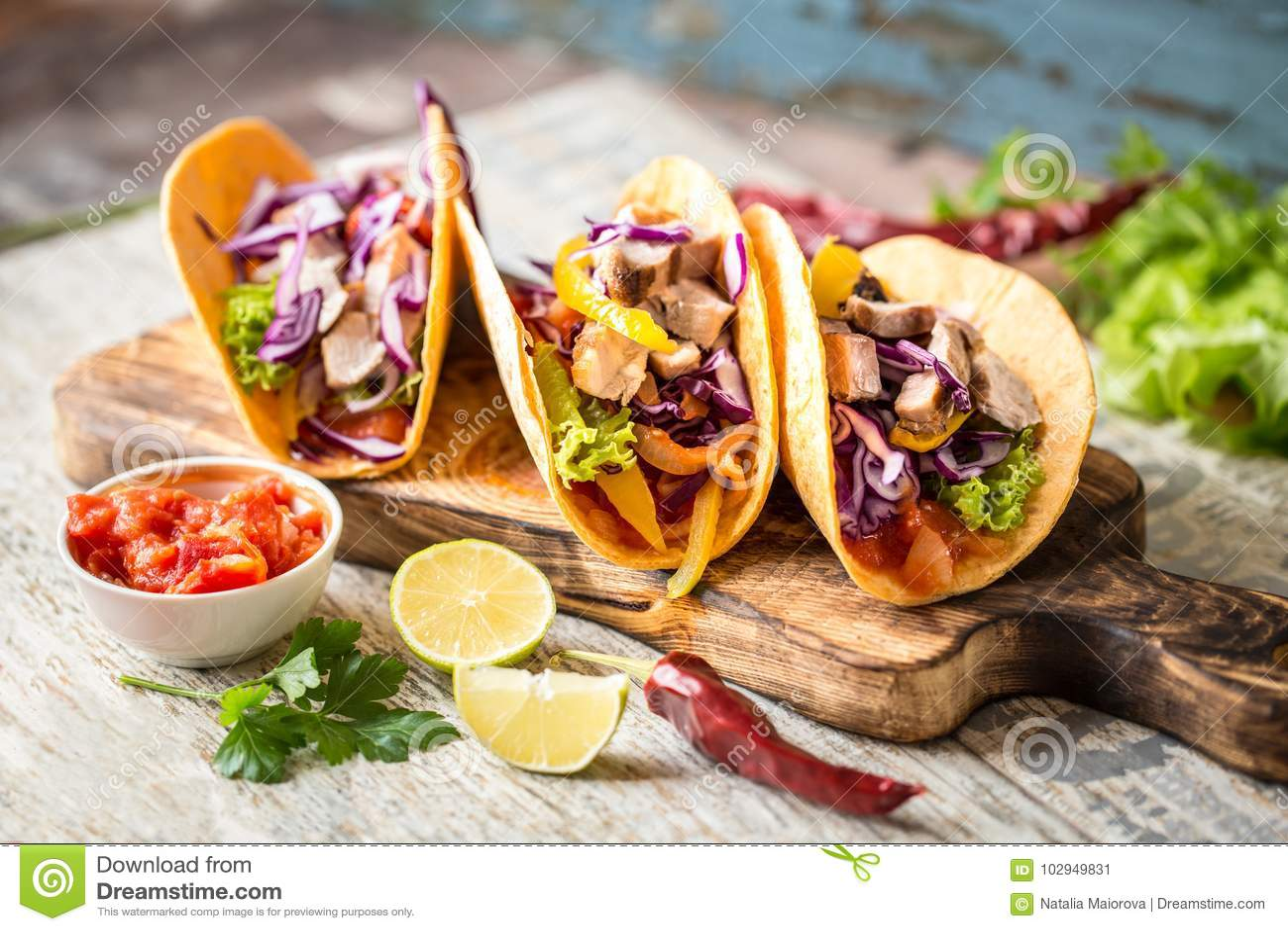 Mexican food tacos, fried chicken, greens, mango, avocado, pepper, salsa