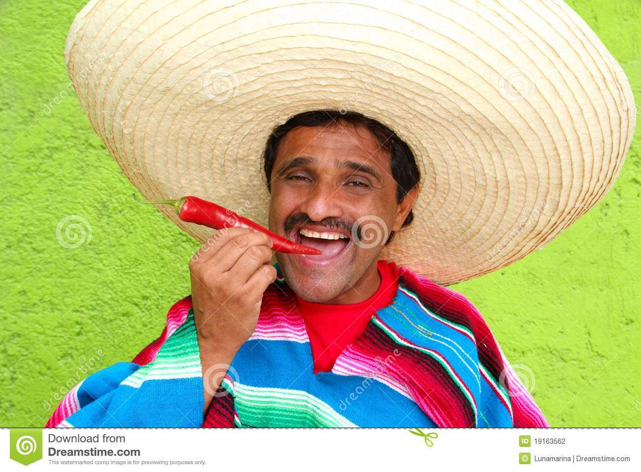 Mexican Man Poncho Sombrero Eating Red Hot Chili Stock Photography ...