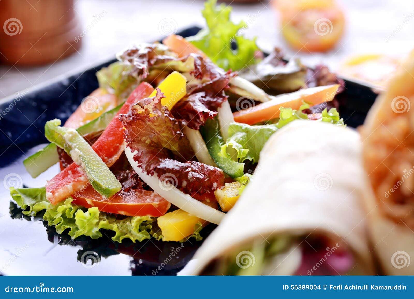Mexican mango salsa with burritos