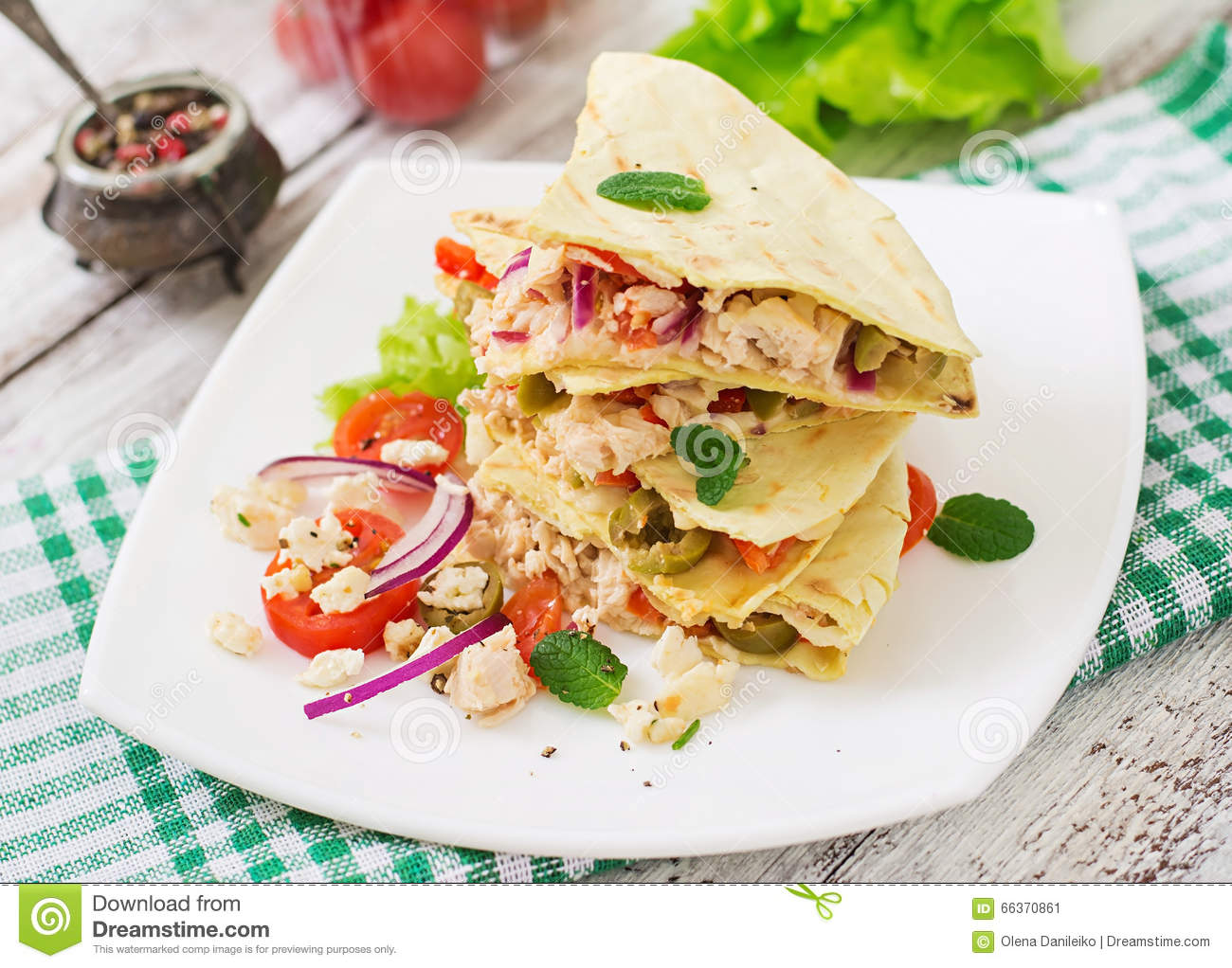 Mexican Quesadilla wrap with chicken, olives, sweet pepper and salad.