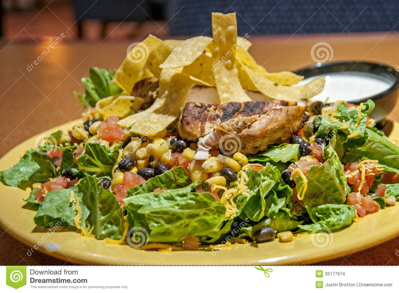 This is a mexican salad with a grilled chicken and a corn and black ...