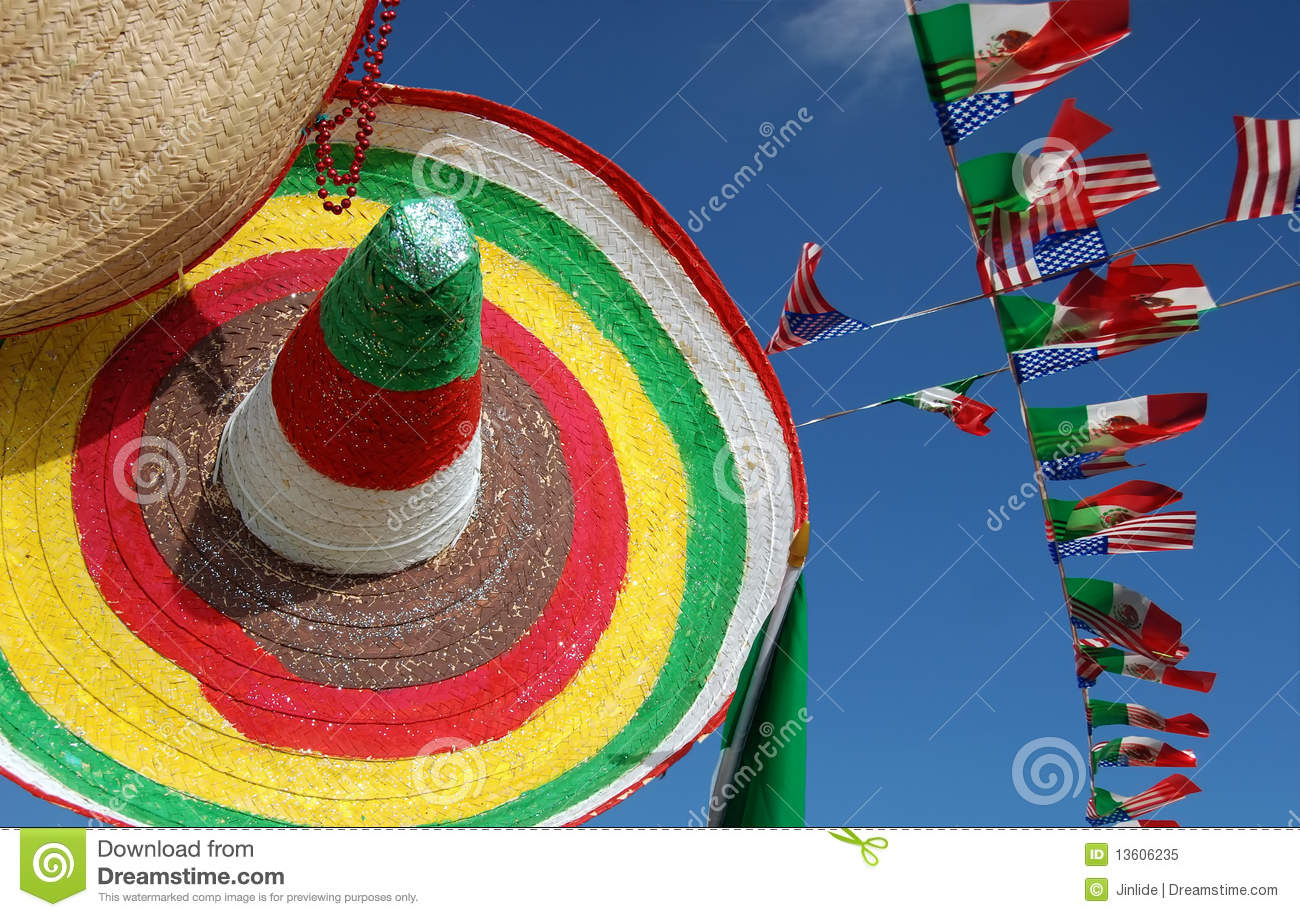 Mexican strawhat with many flags on blue sky