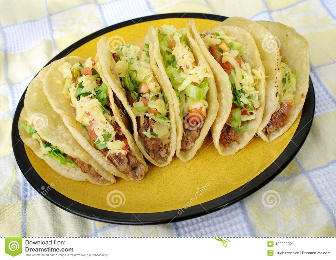 Mexican tacos on a plate stock photo. Image of cheese ...