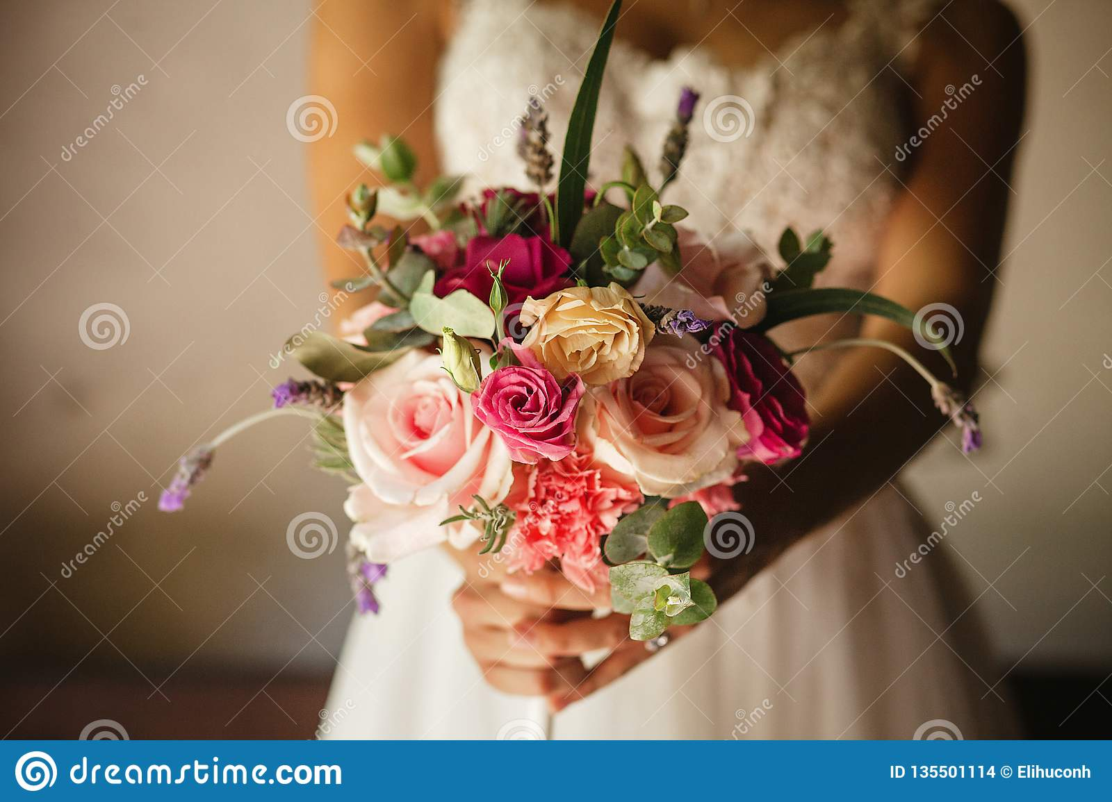 mexican wedding bouquet of flowers in the hands of the bride