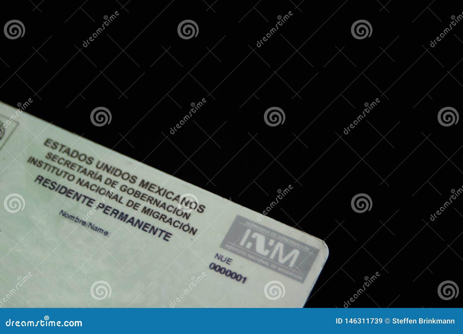 Mexicansk uppeh?llstillst?nd med logoen av den mexicanska invandringadministrationen