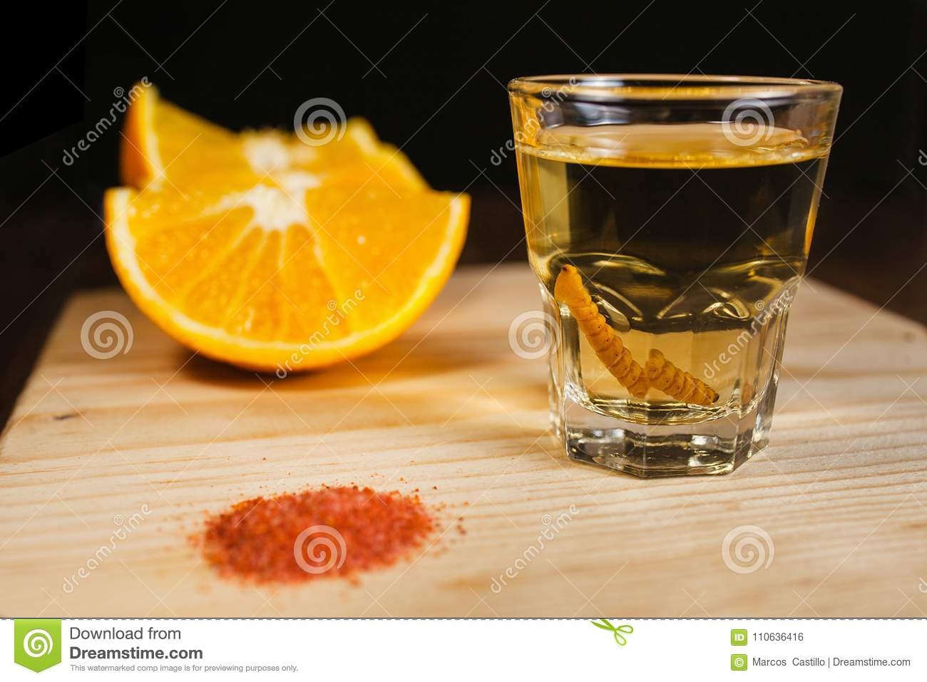Mezcal shot mexican drink with orange and worm salt in oaxaca mexico