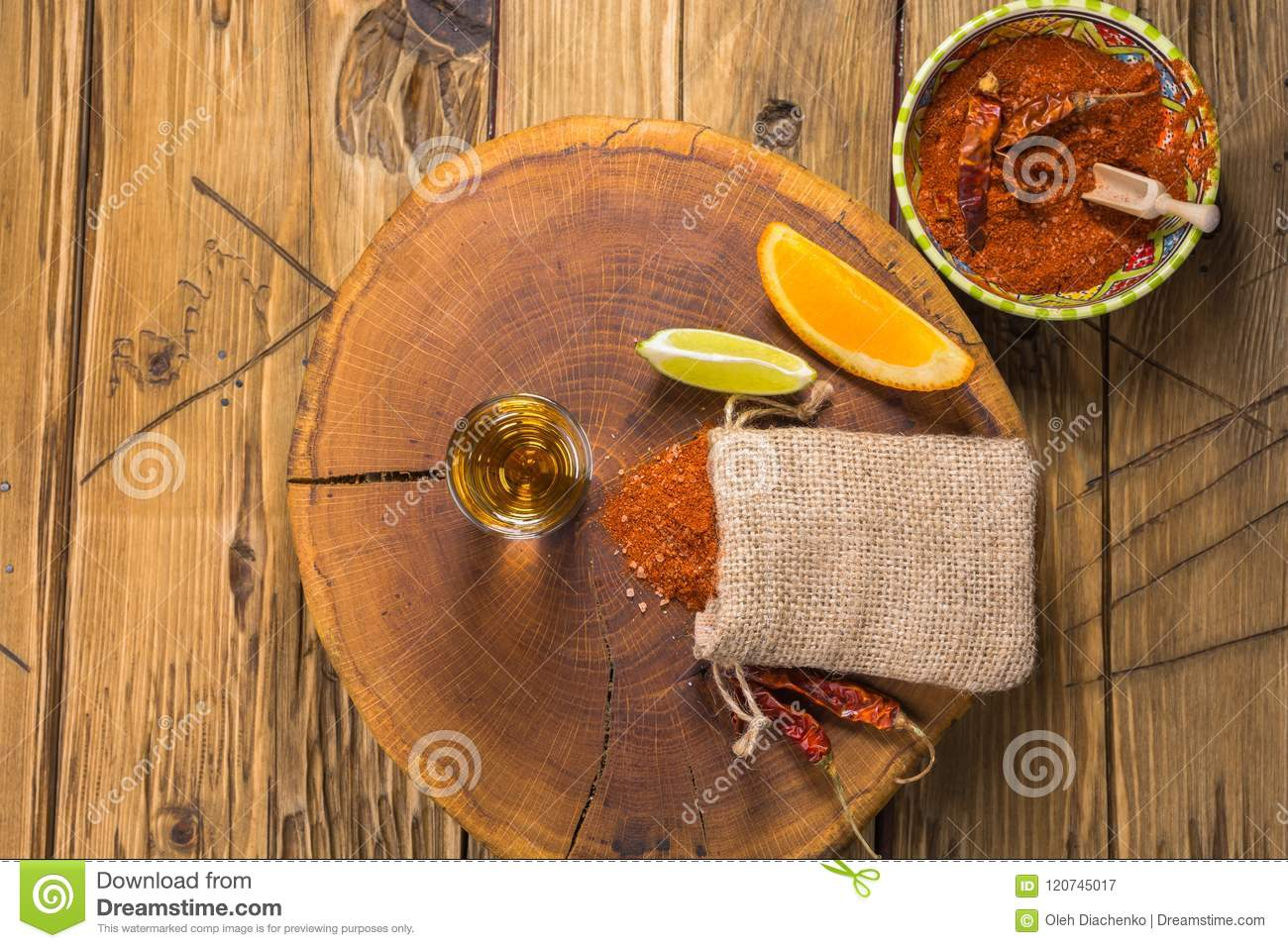 mezcal mexican drink with orange lime slices and worm salt in