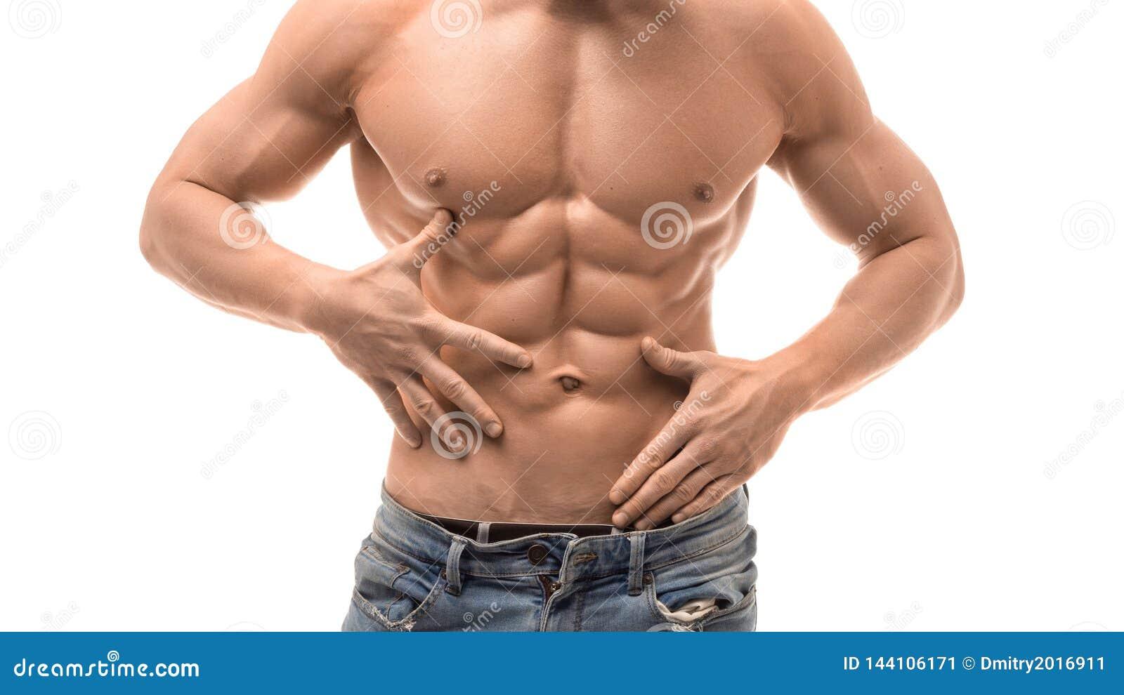 Mięśniowa Męska półpostać Odizolowywająca na bielu Bez koszuli mężczyzna dotyka jego abs w błękitnych jaens