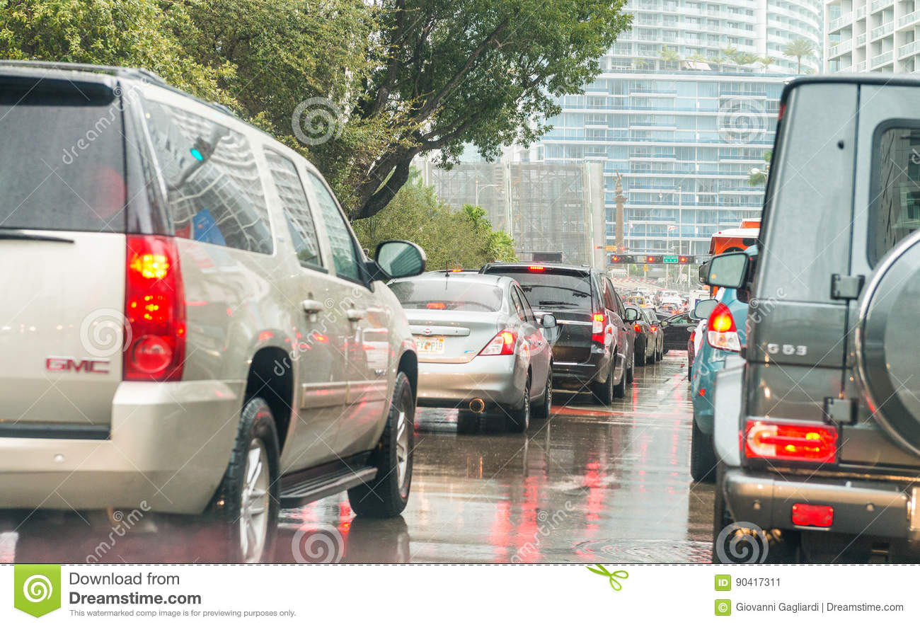 MIAMI, FL - FEBRUARy 23, 2016: City traffic on a rainy afternoon
