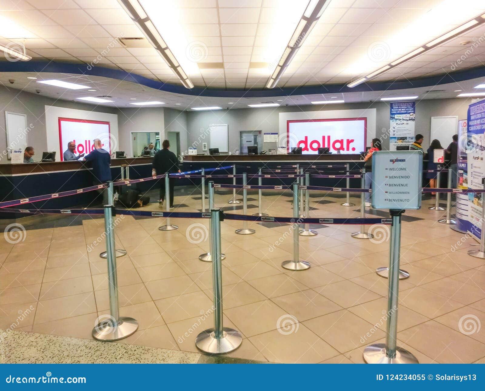 Miami Florida, USA - Aprile 28, 2018: Kontoret för uthyrnings- bil för dollar på den Miami flygplatsen