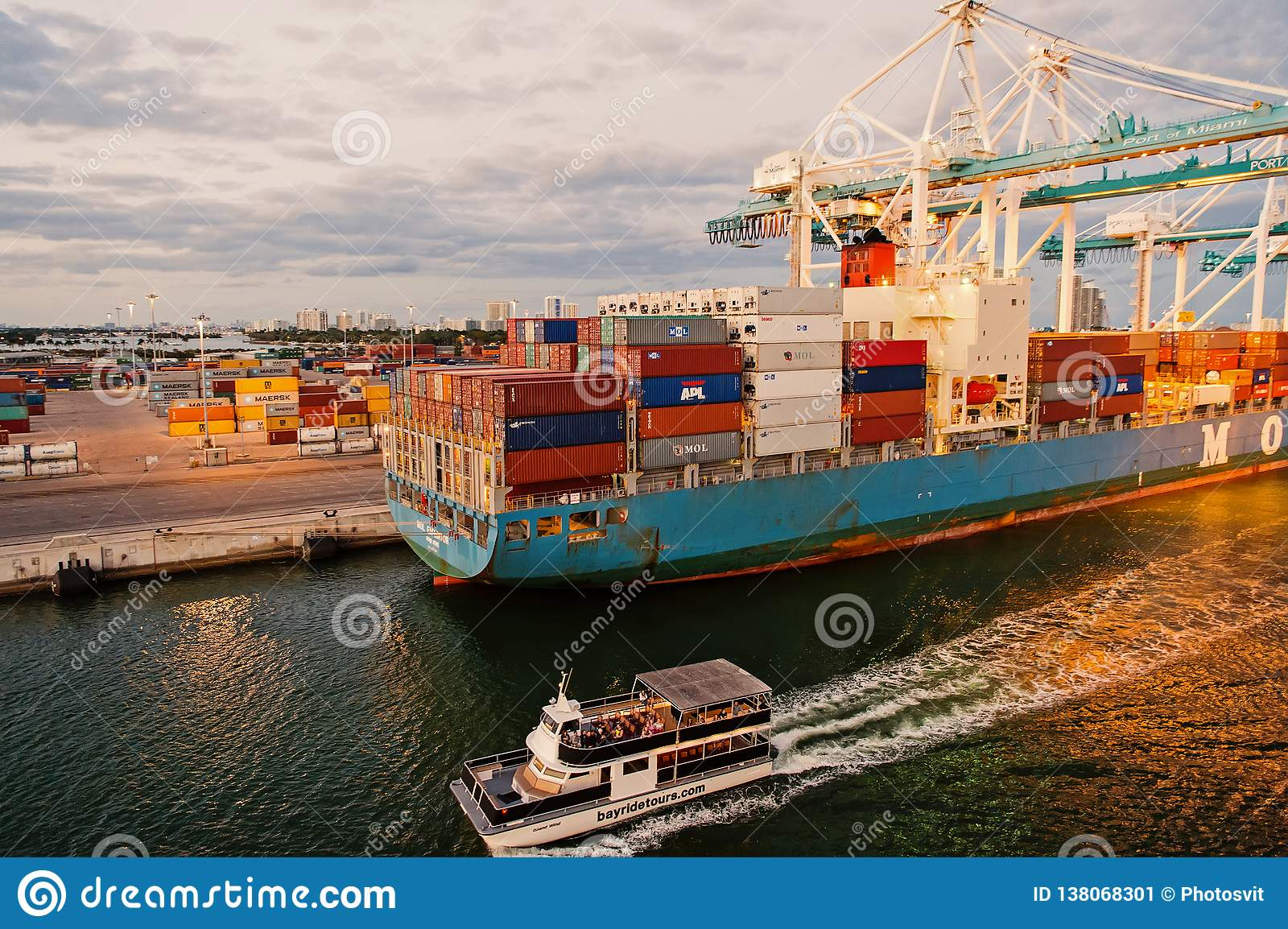 Miami, USA - March 01, 2016: cargo ship and pleasure boat in maritime container port. Sea port or terminal with