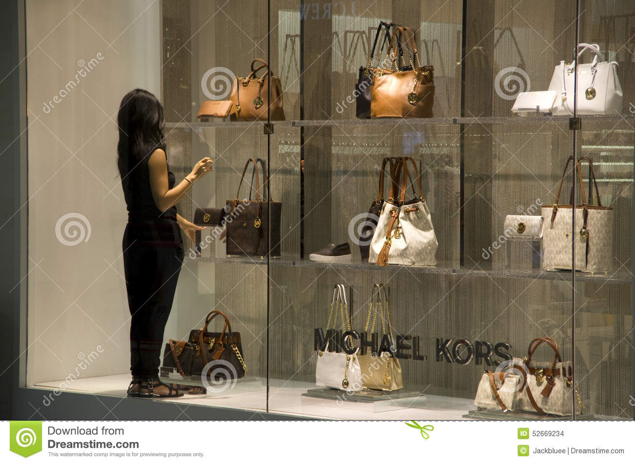 e4e19b45b87c A shop worker was decorating the window of Michael Kors shop in Alderwood  Mall Lynnwood, near Seattle.