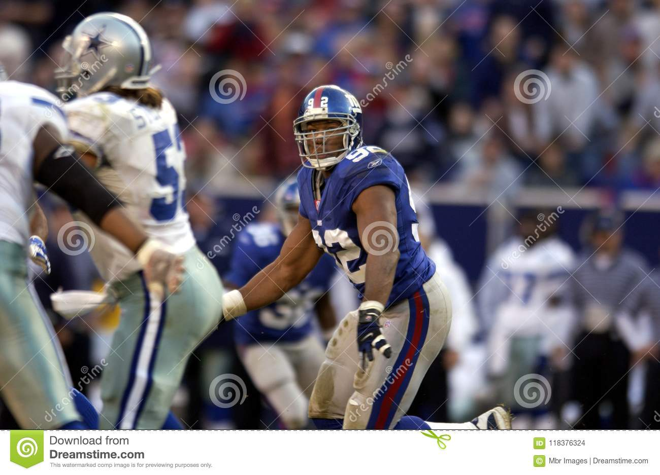 78fcefa242f Michael Strahan Defensive End for the New York Giants in game action during  a regular season game.