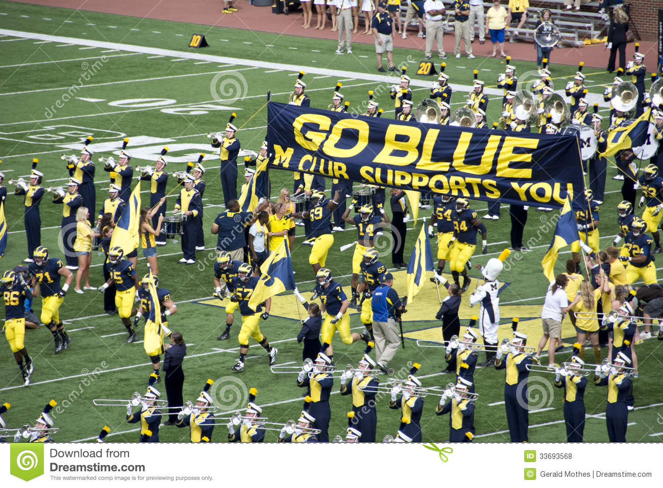 michigan wolverines take the field editorial stock photo