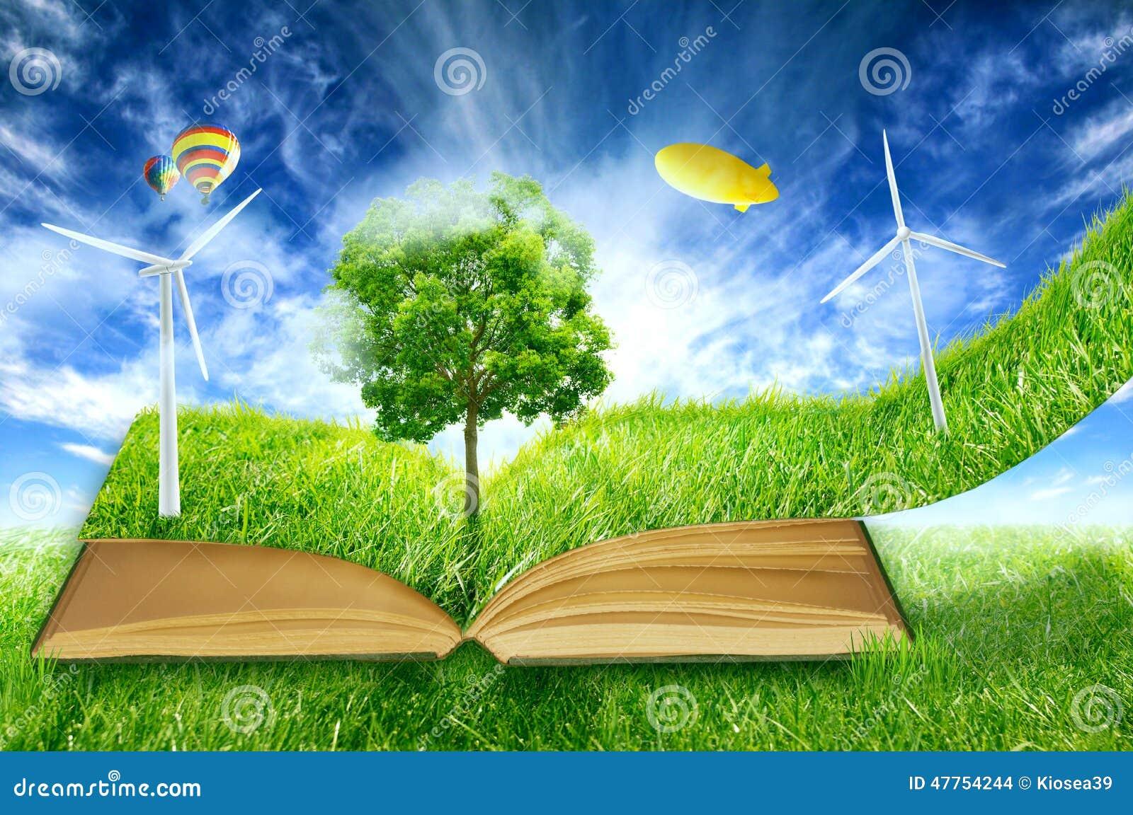 Micro mondo verde, libro coperto di turbine dell energia eolica dell erba verde
